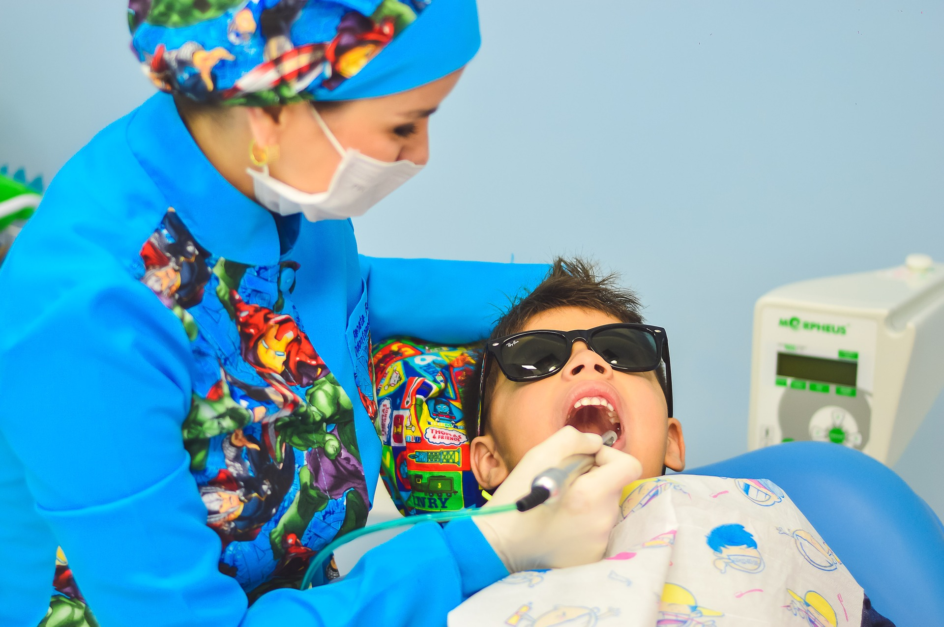 Dentist checking a patient's teeth