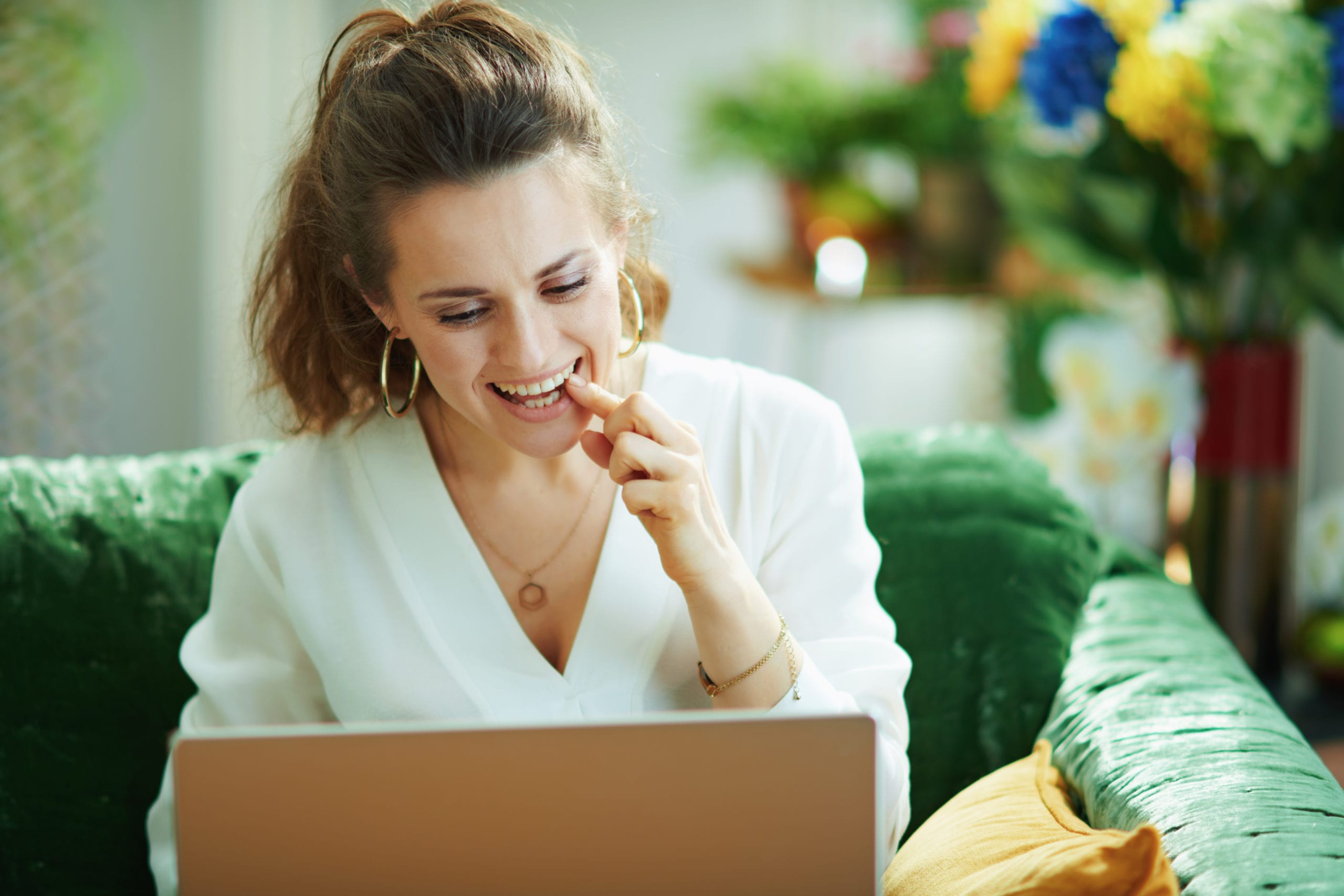 Woman pointing to her tooth during an online dentist appointment