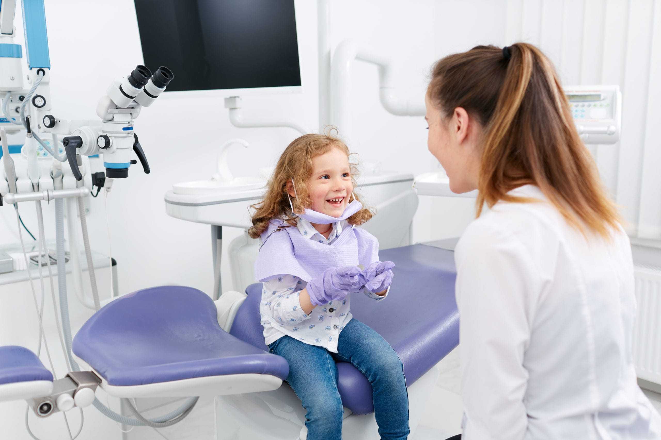 child and dentist at an appointment